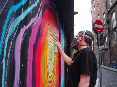 Street artist doodling at Temple Bar, the culture heart of Dublin, Ireland.