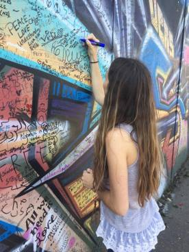 signing peace wall