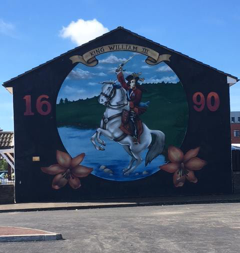 A mural on the side of a Protestant home.