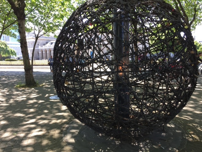 """A public art installation we came across in Dublin called """"Universal Links on Human Rights."""" The piece was covered in love locks"""