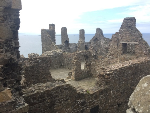 Dunluce Castle. Displays on the wall helped us understand what would have took place in each room of the castle.
