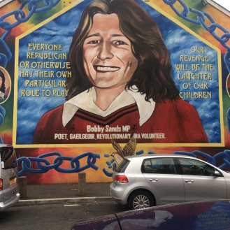 Irish-Catholic side deifies Bobby Sands, IRA politician elected to parliament. Killed in fighting in Belfast.