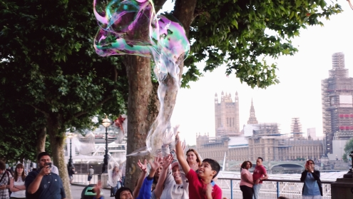 Some children playing bubbles